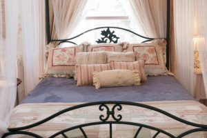 Romantic and comfortable queen size bed.