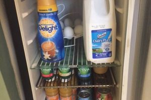 The min-frig in the butlers pantry has a variety of yogurt, juices, and milks.