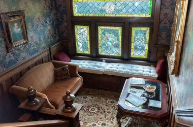 Window seat bench with Tiffany style stain glass windows
